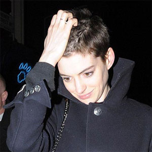 Anne Hathaway happy with short hair