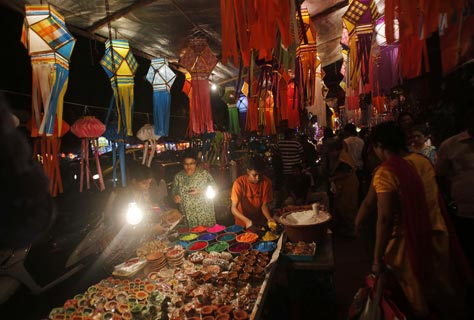 People buy lanterns and other decorative items from roadside stalls ahead of Hindu festival of lights Diwali, in Mumbai.