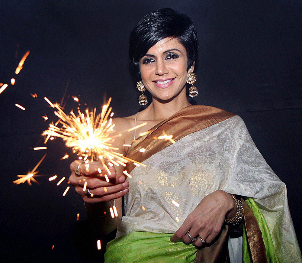 Bollywood actress, model and television anchor Mandira Bedi celebrates Diwali during the opening of her new designer store in Mumbai.