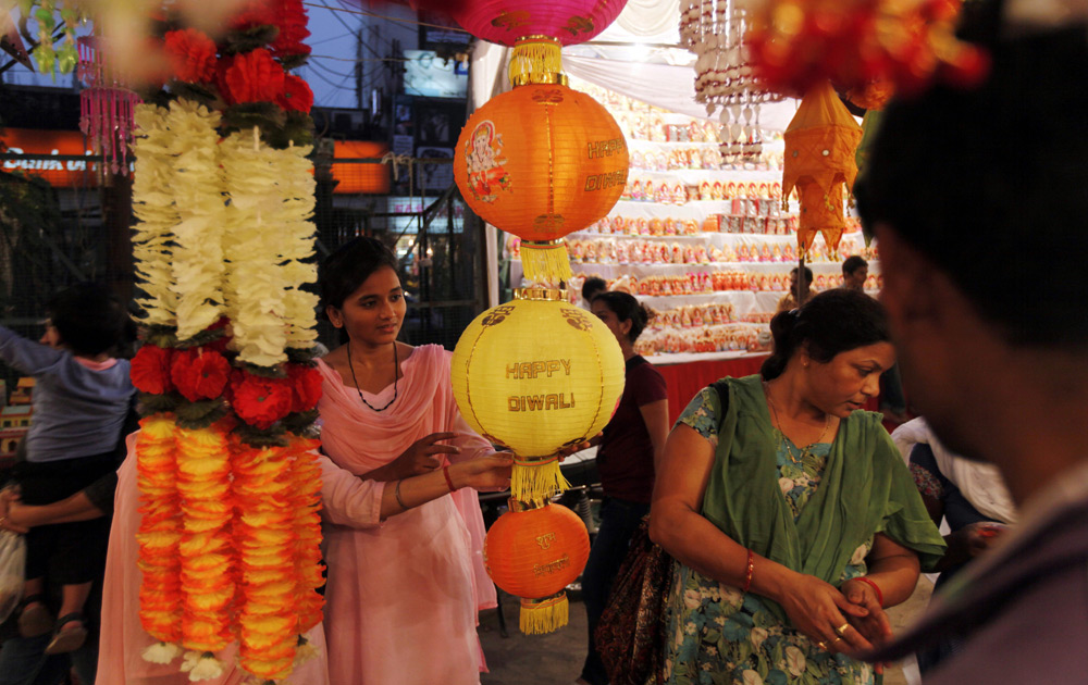 Women shop for artificial garlands ahead of Diwali in Allahabad.