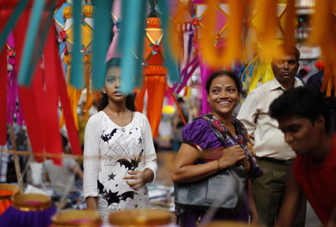 People shop for lanterns at a roadside stall ahead of Diwali in Mumbai.