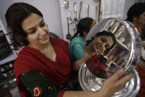 A woman shops for utensils during Dhanteras, which marks the beginning of Hindu festival of lights Diwali, in Jammu.