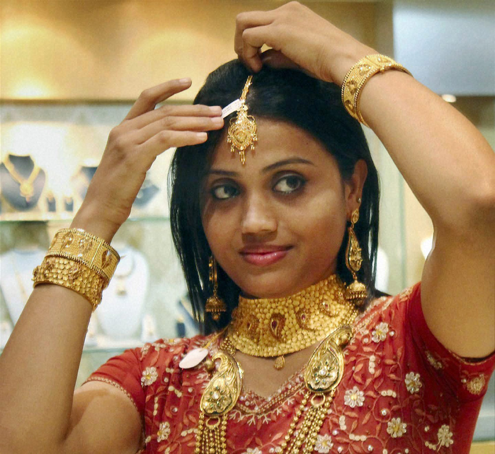 A woman with gold ornaments at a jwellery shop on the occasion of Dhanteras in Jamshedpur.