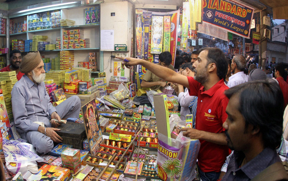 People busy buying crackers for Diwali festival in New Delhi.
