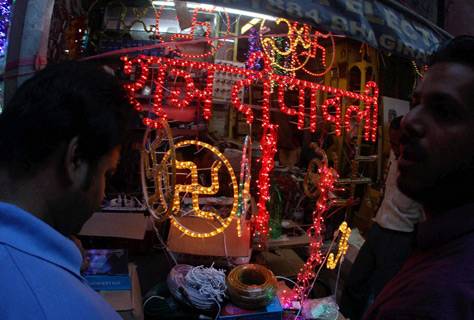 People busy buying lights for Diwali festival in New Delhi.