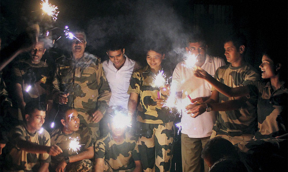 Border Security Force jawans celebrating Diwali by lighting crackers at the India-Bangladesh border in South Dinajpur district of West Bengal.