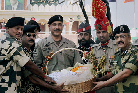BSF Officials presenting sweet basket to Pakistan Ranger Official on the occasion of Diwali at Amritsar.
