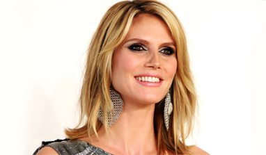 Heidi Klum feels children should earn rewards