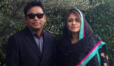 A.R. Rahman, with wife Saira Banu, attends Grammy 2013 red carpet