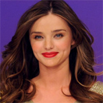 Miranda Kerr gets half-naked for bridal lingerie photoshoot