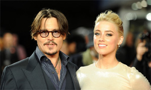 Johnny Depp`s `serious` about Amber Heard