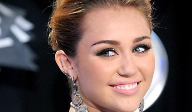 Miley Cyrus flaunts bum cheeks in raciest shoot yet