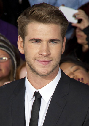 Liam Hemsworth parties at Cannes without Miley Cyrus