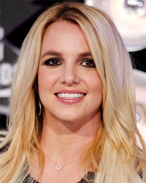 Britney Spears flaunts new bikini body and admits `dieting is tough`