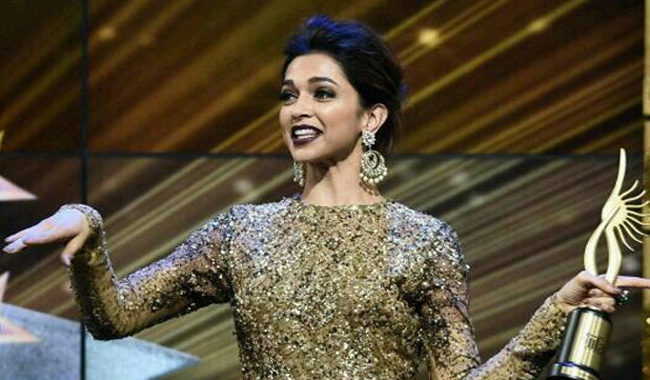 Deepika Padukone grabs the best actress trophy at IIFA 2014